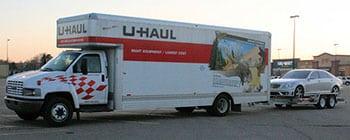 Big U-Haul truck with car on trailer